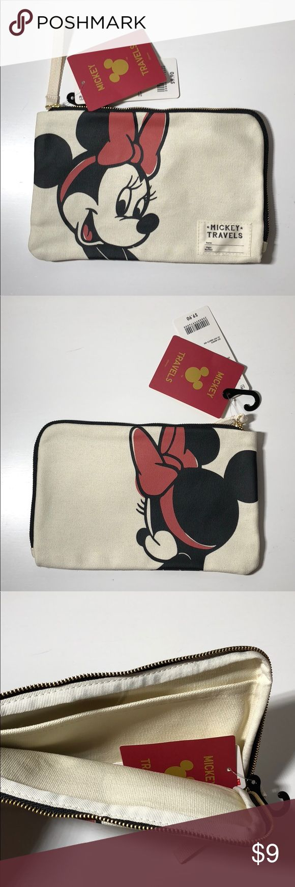 """Minnie """"Mickie Travels"""" Pouch This Minnie """"Mickey Travels"""" bag was purchased at Uniqlo. It is brand new with tag and super cute! It's about 8.5 inches in length and 5.5 inches in width. It also has an inside pocket. Uniqlo Bags Cosmetic Bags & Cases"""
