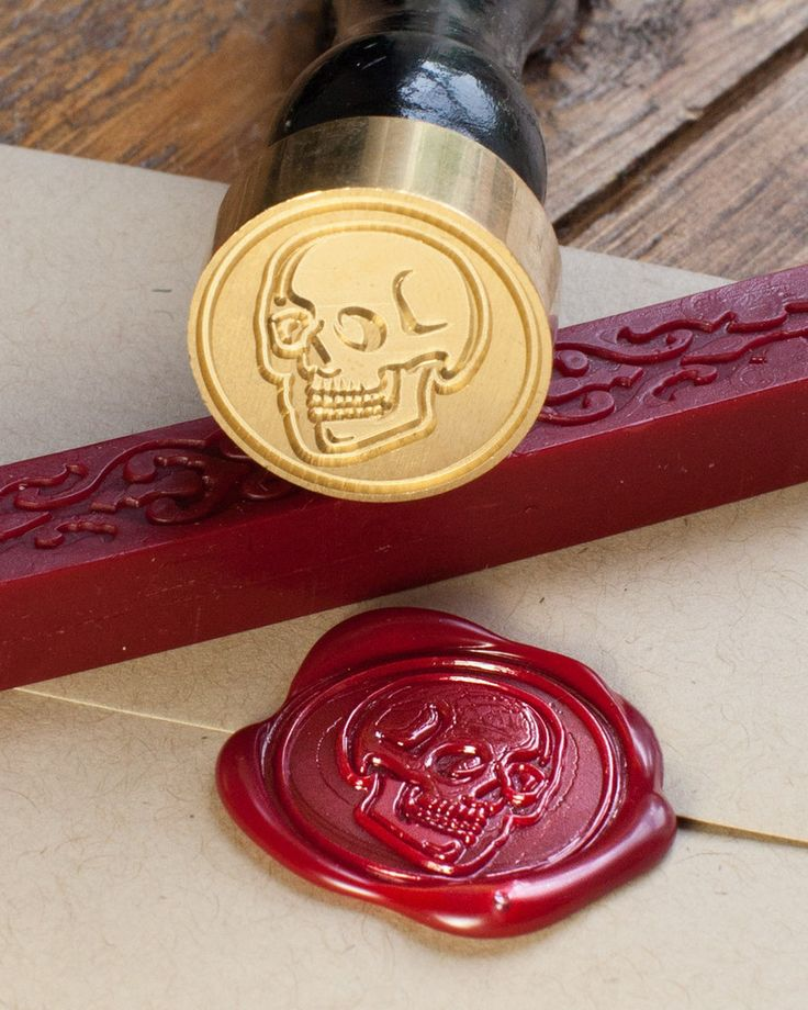 Seal your letters, halloween party invites or anatomically-themed wedding invitations with this anatomical skull wax seal kit. These sealing wax kits make great birthday gifts for people who already have everything, and they give your stationery some vintage flair.  Each seal comes in its own kraft box with a stick of traditional red mailable sealing wax with a wick for quick and easy use. Light the wick and allow a pool of wax to collect on your envelope, then press the seal into the…