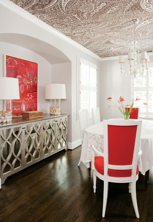 Dark floors, patterned ceiling, pops of color