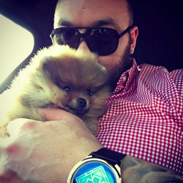 ...except for when he's holding his new Pomeranian puppy named Asterix.