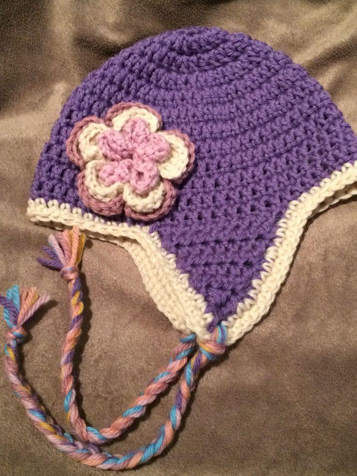 Dark lavender beanie with flower. 100% wool.
