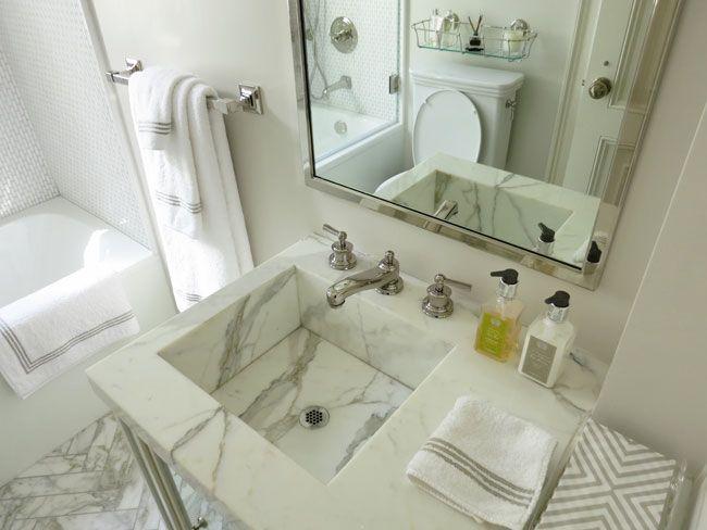 Christina Murphy Interiors - square marble sink washstand - chevron towels - herringbone pattern marble tiles