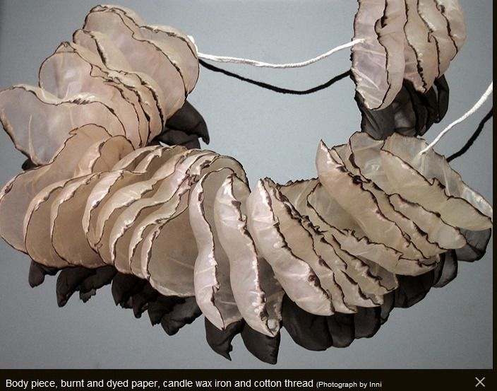 Inni Pärnänen - Finnish jeweller - body piece -burnt paper & wax