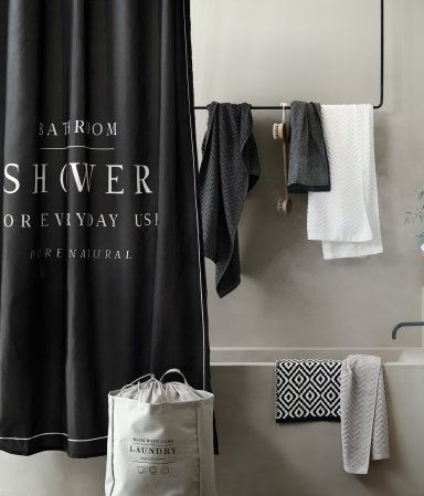Black. Shower curtain in water-repellent polyester with printed text. Metal grommets at top. Shower curtain rings sold separately.