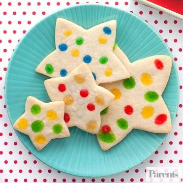 """Knead 2/3 cup flour into 1 lb. refrigerated sugar-cookie dough; roll to about 1/4"""" thick. Make the stars using an assortment of 2"""" to 3-1/2"""" cookie cutters. Place on parchment paper-lined cookie sheets about 2"""" apart and have your artists in residence squirt on dots with Cake Mate decorating gels. Bake at 350?F until golden, about 6 to 8 minutes. Makes about 3 dozen."""