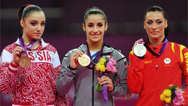 (R-L) Silver medalist Catalina Ponor of Romania, gold medalist Alexandra Raisman of the United States of America and bronze medalist Aliya Mustafina of Russia pose on the podium during the Victory Ceremony for the women's Floor Exercise final on Day 11 of the London 2012 Olympic Games at North Greenwich Arena