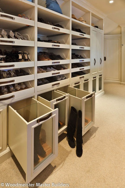 Boot Storage - A closer look at Woodmeister Master Builders' work in this traditional home reveals a glass partition, which means you can store two pairs per shoe shelf.