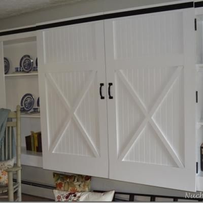 How cute is this.  Turn your old closet doors into Barn Doors.