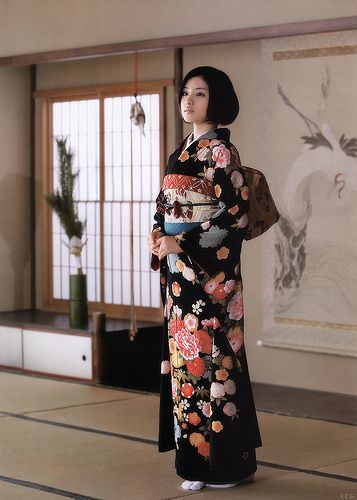 """KIMONO The kimono (着物 ? ) [1] is a Japanese traditional garment. The word """"kimono"""", which literally means a """"thing to wear"""", [2] has come to denote these full-length robes. The standard plural of the word kimono in English is kimonos. On certain events, it is proposed that you dress in a kimono, in most times you will need a helping hand to get into one. It is not as easy it looks, if you want to wear it appropriately. Men,Women and children alike adorn kimonos."""
