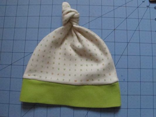 """This free tutorial is part of The Great Knit Fabric Experiment sponsored by Harmony Art Fabrics and Stitch Simple, where you can buy your fabric prewashed and ready to sew. More great free tutorials for sewing with knits at the link, or click the logo! Knit fabric is a necessity when sewing for baby – … Continue reading """"Free Baby Knot Hat Pattern and Tutorial"""""""