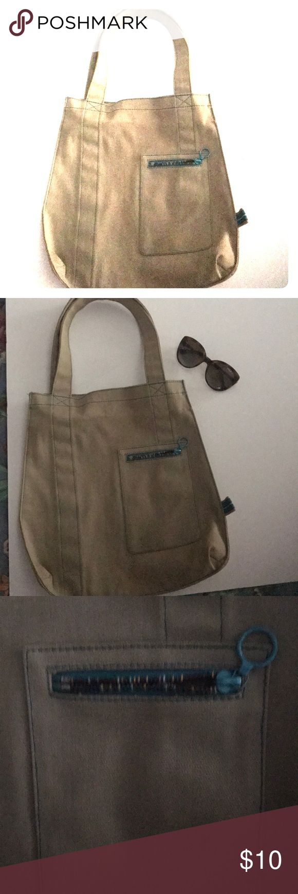 Khaki Gap Tote Bag Super cute urban chic khaki Gap tote bag.  Zipper pouch in from and turquoise stitching trim. GAP Bags Totes