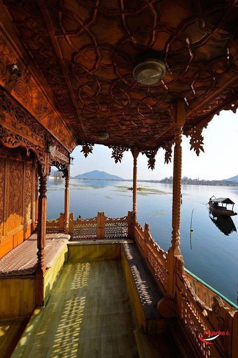 kashmir, India...These houseboats are made of wood, and usually have intricately carved wood paneling. Taken at Kashmir,India