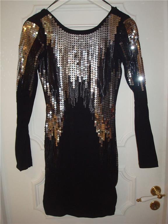 Glittrande paljettklänning i svart/silver på tradera.com