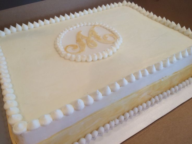 Gold monogram sheet cake