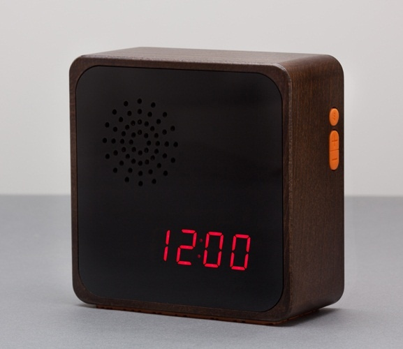 Alba (Media Edition) Digital Clock 'Dark Wood'  Solid wood casing handmade in Montreal, Canada.  Smoked Acrylic face, non-slip silicone base with debossed graphic and soft tactile silicone buttons.  Built in Audio amplifier and speaker (standard 35mm lineout port for iphone/ipod). Built in alarm with sleep function. Larger 10 stage dimmable LED display.   A Furni limited edition clock, completely sold out elsewhere, a real collectors piece. $125.95.