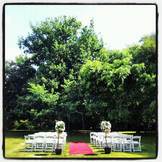Simple Outdoor Ceremony using White Americana Folding Chairs @ Chateau Yering