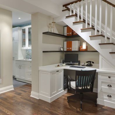 Quaint yet spacious corner  desk built underneath a staircase. Great storage for a small house!