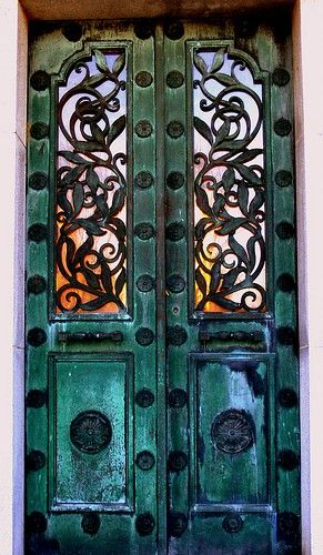 Lacy wrought iron doors.