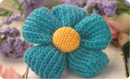 Quick knit flower brooch. A nice little project. Would make a good gift or accent on a hat or baby dress.
