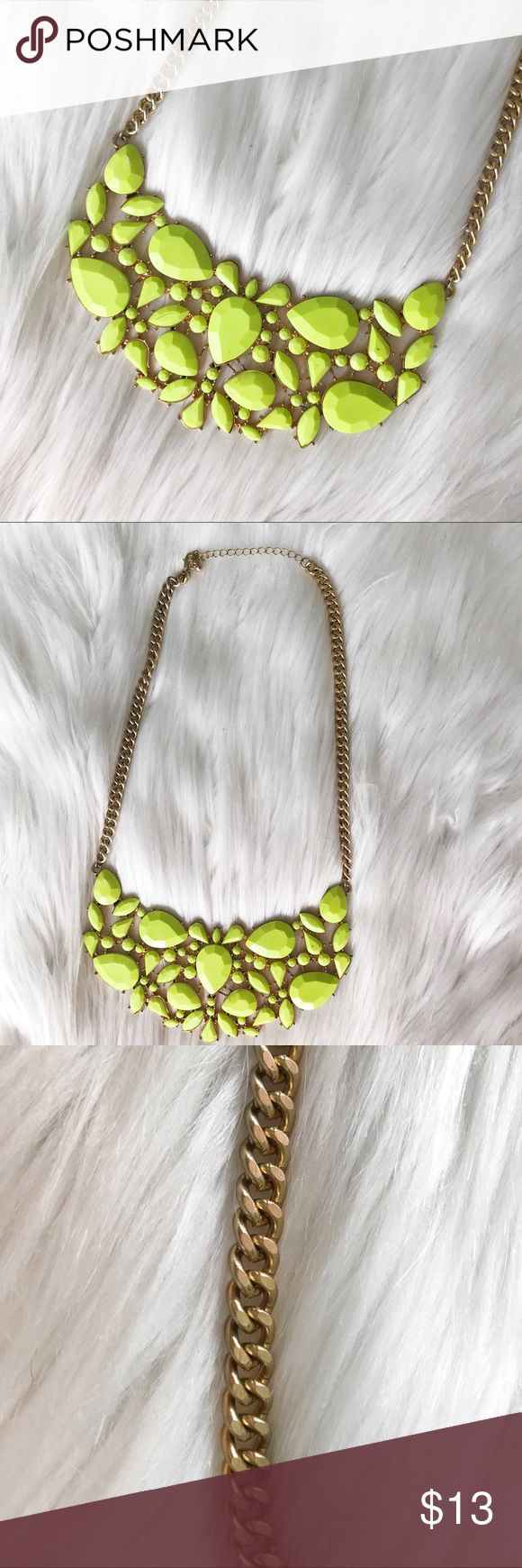 Neon statement necklace Neon green/ yellow statement necklace with gold chain and settings. There is some slight light marks as shown in last photo. Hardly used Jewelry Necklaces