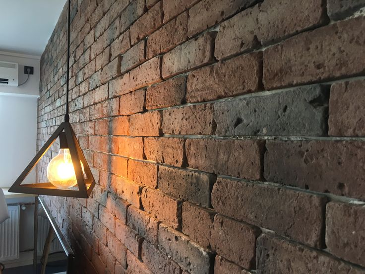 Brick wall with wood lighting in Bucharest, 2 rooms apartament