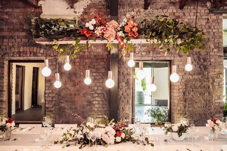 We love everything about weddings! Here is a lovely example using lighting as part of decor! The touch of colour in the flowers combined with white light and raw unfinished brick walls, creates a rustic yet sophisticated feel.
