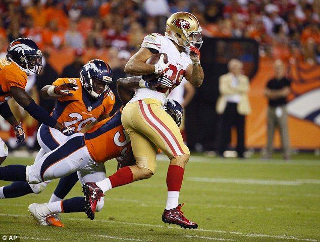 Jarryd Hayne runs the ball against the Denver Broncos in a preseason game on August 29