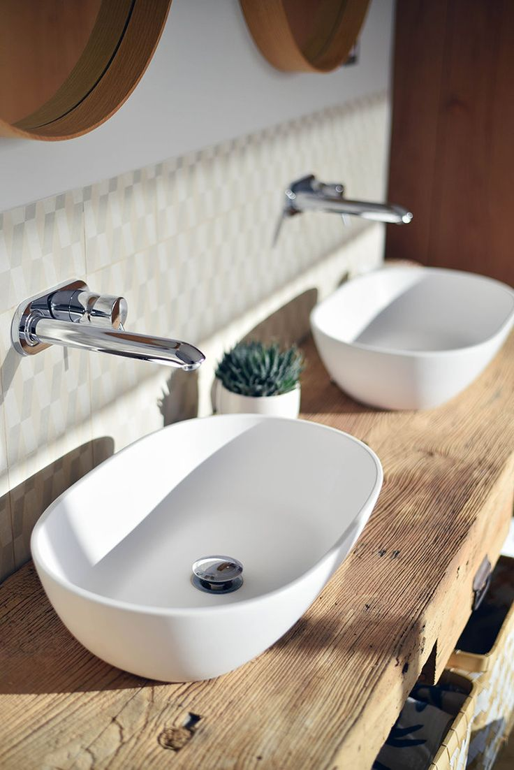 Claudia Urvois Interior Design Master Bathroom double sinks with wall rounded wall faucets on old woodworker's bench from Spanish Pyrenees.