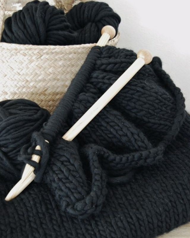 """Pattern for a knit throw blanket in a cool black yarn that is actually """"comprised of midnight blue, forest green, and gray tweed to add a little dimension to the black color"""".  Would love to make this and use this yarn."""
