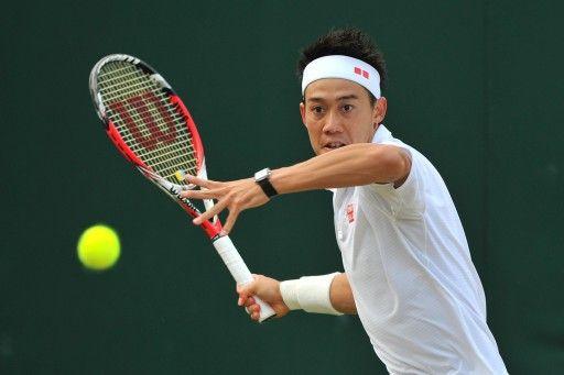 テニス、ウィンブルドン選手権(The Championships Wimbledon 2014)男子シングルス3回戦。リターンを狙う錦織圭(Kei Nishikori、2014年6月28日撮影)。(c)AFP=時事/AFPBB News