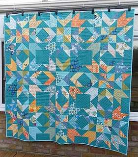 Beautiful turquoise quilt with royal, orange, and green thrown in to liven things up. Love it!