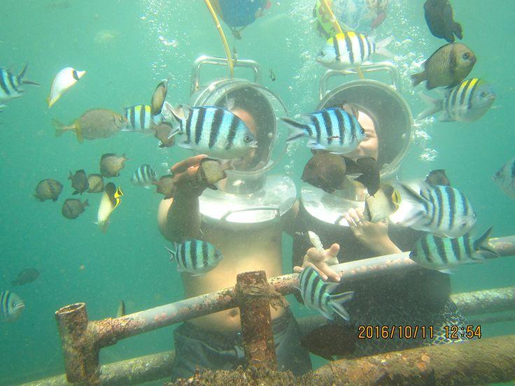 walking underwater on seafloor on Tanjung Benoa,Bali
