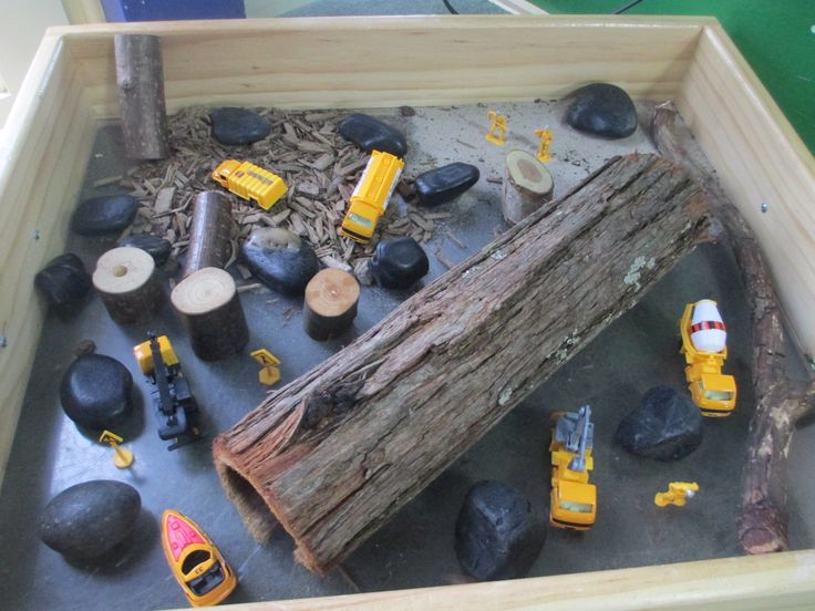 Construction zone! Trucks, signs and tools with wood, dirt, stones and sand. Imaginative play scene for vehicles and transport and jobs people do. Or just for fun!