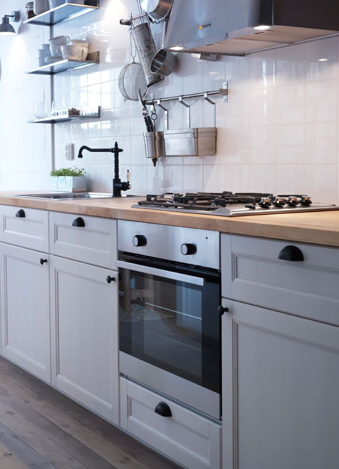 traditional white ikea kitchen with wood worktops black tradtional tap and vintage style door. Black Bedroom Furniture Sets. Home Design Ideas