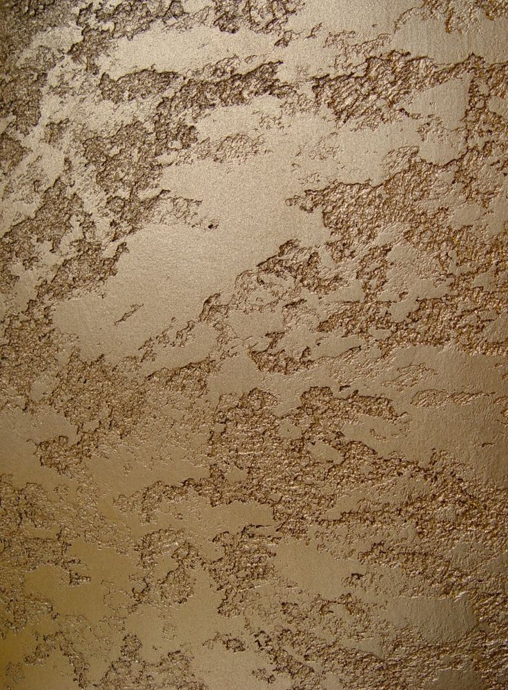 """""""Granite"""" polished plaster decortive wall finish with a gold wash."""