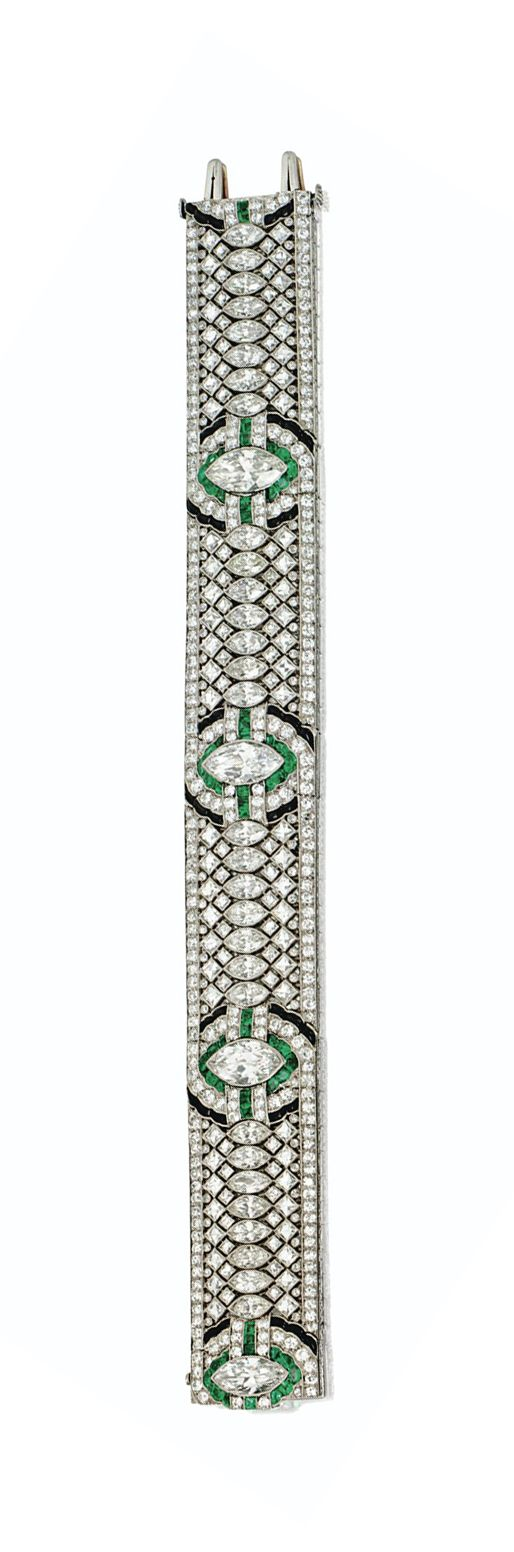 ART DECO DIAMOND, EMERALD & ONYX BRACELET, OSCAR HEYMAN & BROTHERS, CIRCA 1925.  The articulated band set at intervals with 4 marquise-shaped diamonds, outlined by calibré-cut emeralds & further by buff-top calibré-cut onyxes, flanked by rows of 30 smaller marquise-shaped diamonds, within an openwork border of 112 French-cut diamonds & numerous small round & single-cut diamonds together, mounted in platinum, made by Oscar Heyman & Bros., Inc.