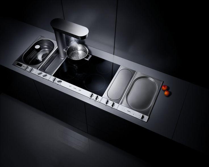 Gaggenau Vario cooking inserts set into grey worktop. From left, VK ... #appliances #gaggenau #kitchen Pinned by www.modlar.com
