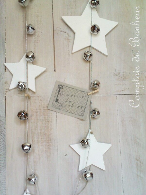 White stars and silver jingle bell garlands, for the windows