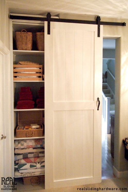 White closet sliding barn doors inside ideas pinterest for Barn door closet door ideas