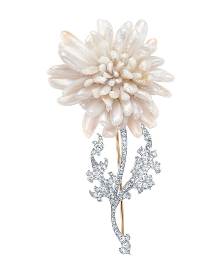 Tiffany & Co. brooch of freshwater pearls in the form of a chrysanthemum, with a stem and leaves of diamonds, set in gold-backed platinum, c...