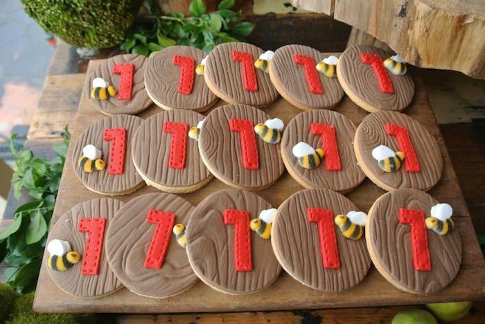 Cute bee cookies at Rustic Winnie the Pooh 1st birthday party via Kara's Party Ideas KarasPartyIdeas.com #winniethepooh #firstbirthday #winniethepoohparty #karaspartyideas