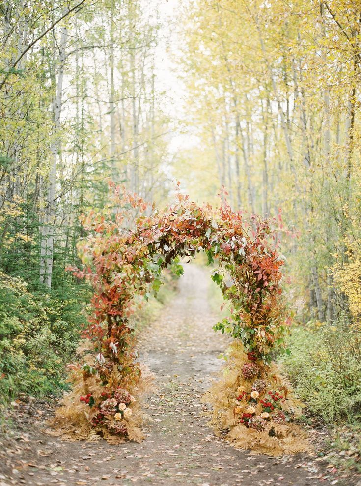 If you love this gorgeous wedding ceremony arch with greens, mustard,  and pinks - Click to see 39 of Our Favorite Ideas for Your Fall Wedding! #FallWedding #Wedding #WeddingInspiration #FallColors #FallInspiration #WeddingIdeas #OctoberWedding #SeptemberWedding #WeddingPlanning | Martha Stewart Weddings