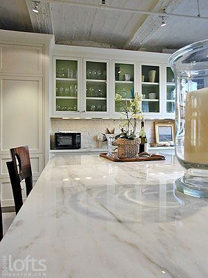 Veined white granite- the look of marble and the durability and ease of granite!