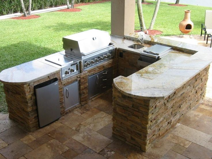 Beautiful U Shaped Outdoor Kitchen Island Using Stone Material In Beige Finish Also Meat Grinder And