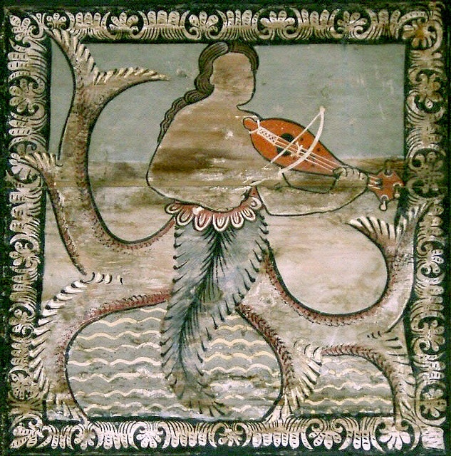Siren (mermaid) playing violin  -  painted wooden ceiling from 1109 to 1114 in the romanesque St. Martin Church, Zillis, Grisons, Switzerland,