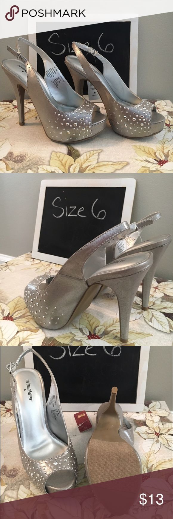 Women's size 6 Silver pumps with high heels Super sexy women's size 6 silver high-heels with small rhinestones and a strap on the back that is adjustable. No Boundaries Shoes Heels