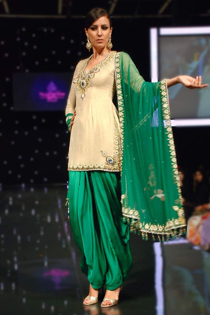 beige kameez paired with green salwar and dupatta
