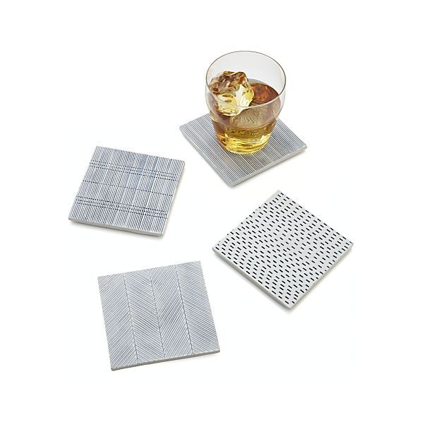 Delicate blue dots and dashes serene geometry on handcrafted porcelain tile coasters, backed in felt to protect surfaces from scratching. Each hand-decorated tile in the set features its own pattern, which will vary from set to set.