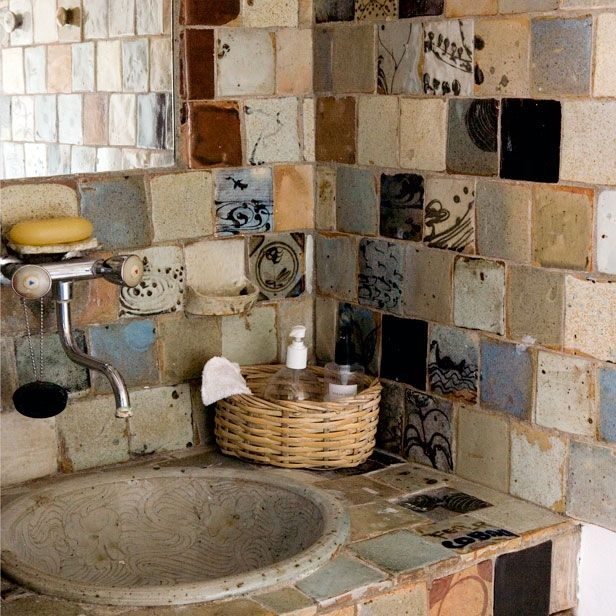 The combination of different travertine tiles and ceramic tiles give a very rustic and artistic aspect to the bath. I love having carved out stone sink because makes this object a unique and original piece.