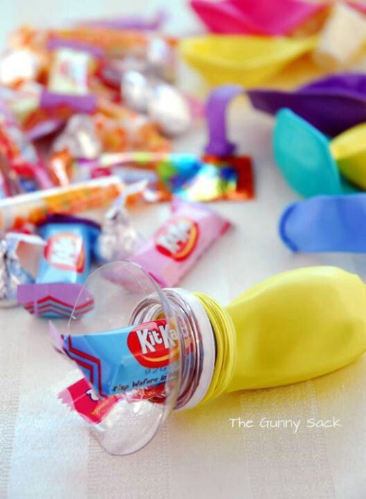 I love this idea to fill candy into balloons for children at the party.  DIY and inexpensive.